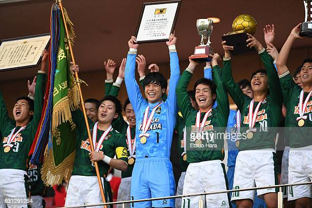Players of Aomori Yamada celebrate their victory after the 95th All Japan High School Soccer Tournament final match between Aomori Yamada and...