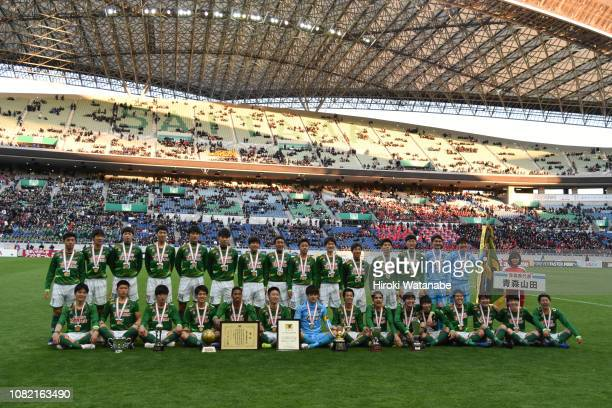 Players of Aomori Yamada celebrate with the championship pennant after the 97th All Japan High School Soccer Tournament final between Aomori Yamada...