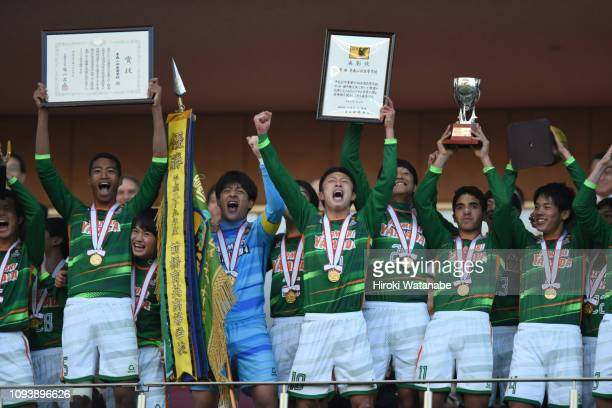 Players of Aomori Yamada celebrate with the chanpionship pennant after during the 97th All Japan High School Soccer Tournament final between Aomori...