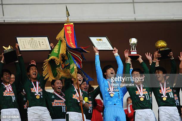Players of Aomori Yamada celebrate with the trophy after the 95th All Japan High School Soccer Tournament final match between Aomori Yamada and...