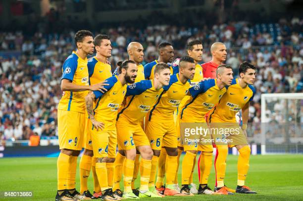 Players of APOEL FC line up and pose for a photo prior to the UEFA Champions League 201718 match between Real Madrid and APOEL FC at Estadio Santiago...