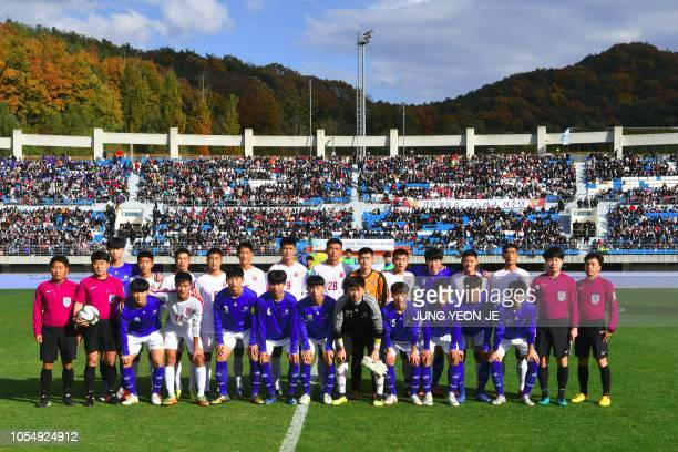Players of April 25 Sports Club of North Korea and Gangwondo team of South Korea pose for photos before their match during the 5th Ari Sports Cup U15...