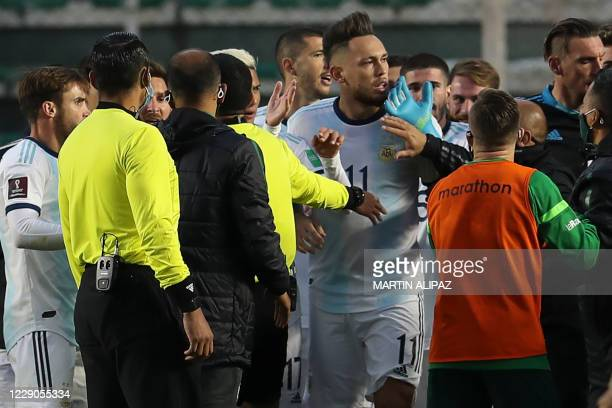 Players of Argentina and Bolivia argue at the end of their 2022 FIFA World Cup South American qualifier football match at the Hernando Siles Stadium...