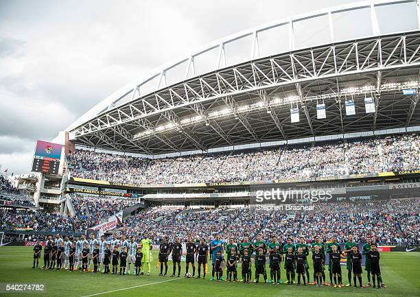 Players of Argentina and Bolivia stand on the field before a group D match between Argentina and Bolivia at CenturyLink Field as part of Copa America...