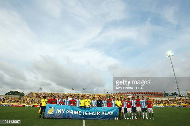 Players of Argentina and Portugal pose behind a banner reading 'My game is Fair Play' before the FIFA U20 World Cup 2011 quarter final match between...