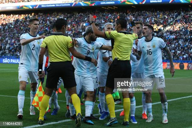 Players of Argentina argue with Referee Mario Diaz de Vivar after showing Lionel Messi of Argentina a red card during the Copa America Brazil 2019...