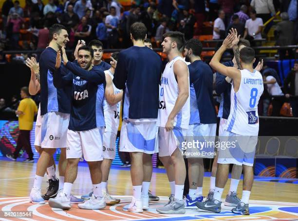Players of Argentina celebrate after a semi final match between Argentina and Mexico as part of FIBA AmeriCup 2017 at Orfeo Superdomo Stadium on...