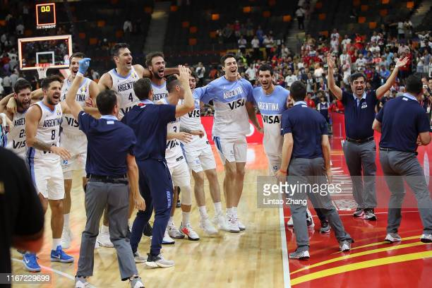 Players of Argentina celebrate after their team's win against Serbia during FIBA World Cup 2019 Quarter-finals match between Argentina and Serbia at...