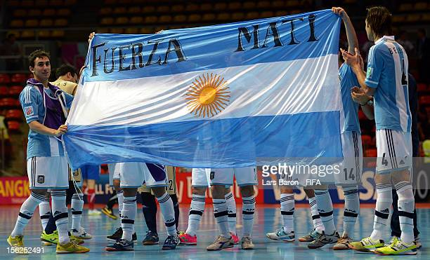 Players of Argentina celebrate after winning the FIFA Futsal World Cup Round of 16 match between Serbia and Argentina at Indoor Stadium Huamark on...