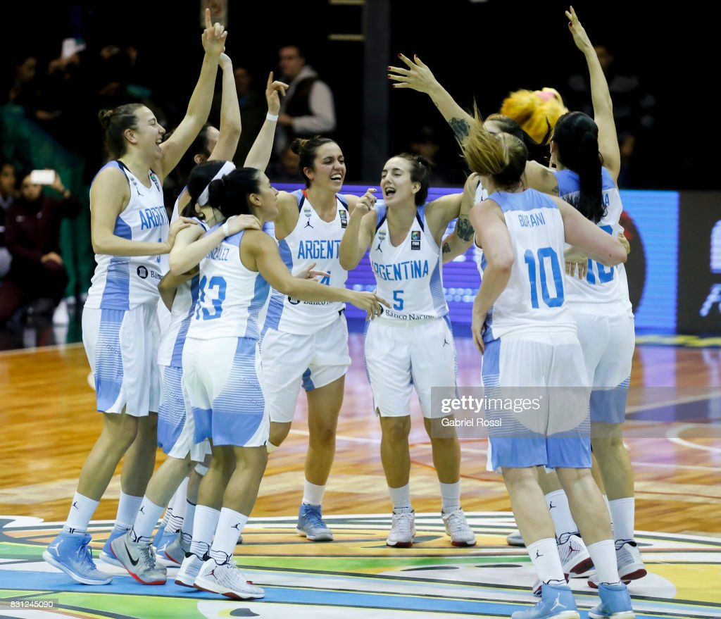 Players of Argentina celebrate after winning the match between Argentina and Puerto Rico as part of the FIBA Women's AmeriCup Semi Final at Obras Sanitarias Stadium on August 12, 2017 in Buenos Aires, Argentina.