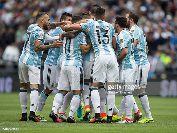 Players of Argentina celebrate the first goal scored by Erik Lamela of Argentina during a group D match between Argentina and Bolivia at CenturyLink...