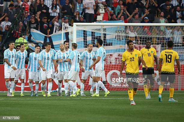 Players of Argentina celebrate the opening goal scored by Gonzalo Higuain during the 2015 Copa America Chile Group B match between Argentina and...