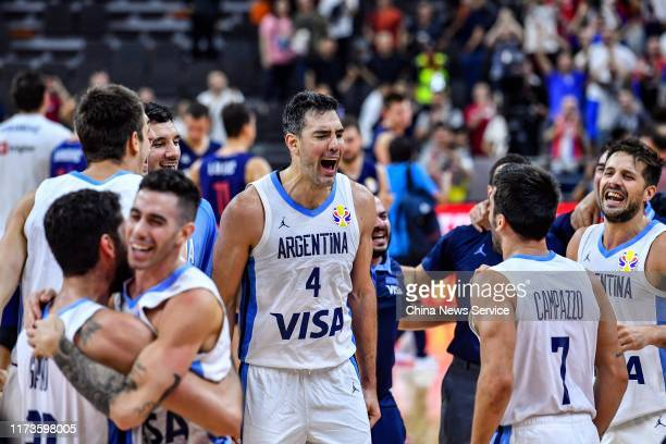 Players of Argentina celebrate victory after FIBA World Cup 2019 quarterfinal match between Argentina and Serbia at Dongguan Basketball Center on...