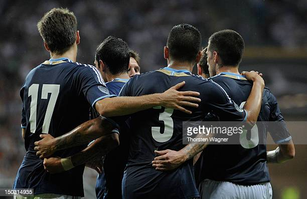 Players of Argentina celebrates after Sami Khedira is scoring the 1:0 with a own goal during the international friendly match between Germany and...