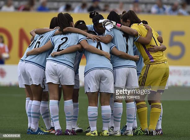 Players of Argentina gather before the start of the women's first round group A football match against Mexico during the Pan American Games in...