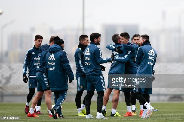 Players of Argentina greet each other during a training session at Spartak Stadium on November 7 2017 in Moscow Russia