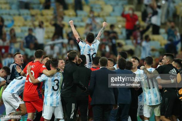 Players of Argentina lift in the air their captain Lionel Messi after winning the final of Copa America Brazil 2021 between Brazil and Argentina at...