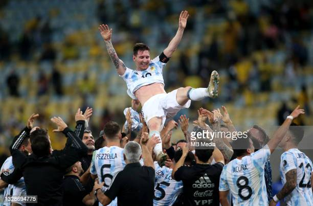 Players of Argentina lift in the air their Captain Lionel Messi after winning the Final of Copa America Brazil 2021 ,during the Final Match between...