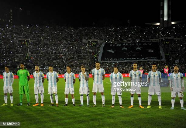 Players of Argentina listen to their national anthem before the start of the 2018 World Cup football qualifier match against Uruguay in Montevideo on...