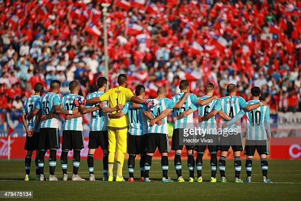 Players of Argentina pause for a minutes silence in remembrance of Chilean motorcyclist Carlo De Gavardo prior the 2015 Copa America Chile Final...