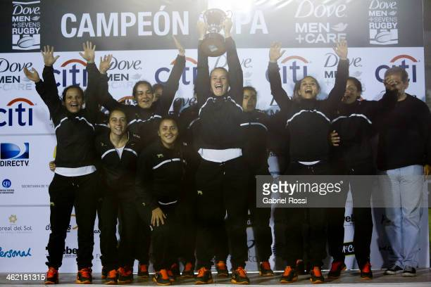 Players of Argentina pose for a photo after winning the womens gold cup final match between Argentina and Uruguay as part of Dove Women's Sevens at...