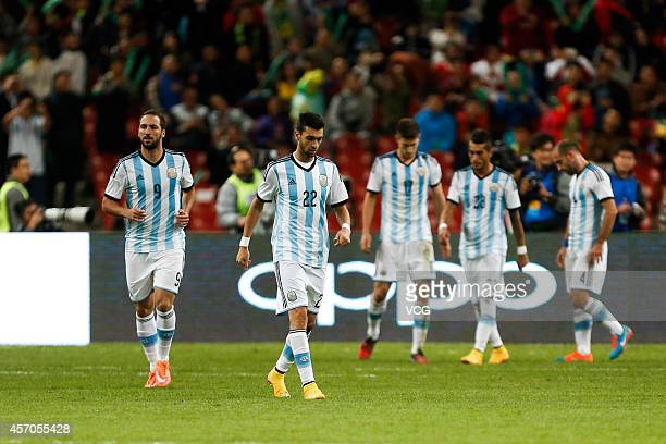 Players of Argentina reacts during a match between Argentina and Brazil as part of 2014 Super Clasico at Beijing National Stadium on October 11 2014...