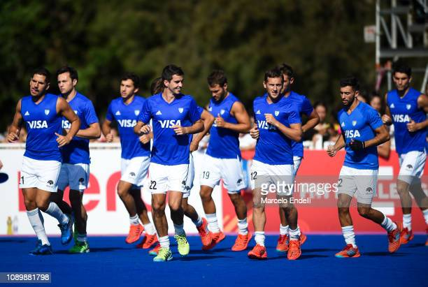 Players of Argentina runs during a warm up before the Men's FIH Field Hockey Pro League match between Argentina and Belgium at Estadio Municipal de...