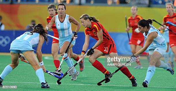 Players of Argentina try to block Janine Beermann of Germany's during their women's bronze medal field hockey match of the 2008 Beijing Olympic Games...