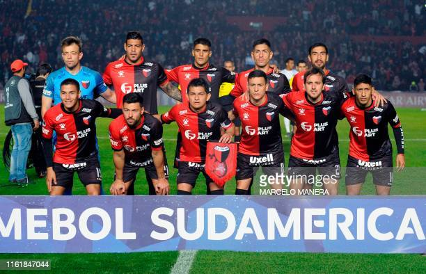 Players of Argentina's Colon pose for pictures before their Copa Sudamericana quarterfinal second leg match against Venezuela's Zulia FC at the...