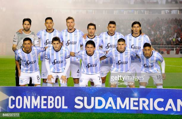 Players of Argentina's football team Atletico Tucuman pose for pictures before the start of their Copa Sudamericana football tournament match against...