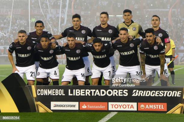 Players of Argentina's team Lanus pose for pictures before the start of the Copa Libertadores semifinal first leg football match against Argentina's...