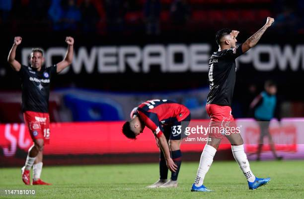 Players of Argentinos Juniors celebrate after a round of sixteen second leg match between San Lorenzo and Argentinos Juniors as part of Copa de la...