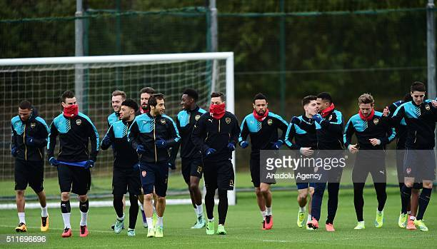 Players of Arsenal attend a training session prior to the Champions League round of 16 first leg soccer match between Arsenal and Barcelona at...