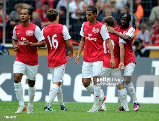 Players of Arsenal celebrates after Gervinho scored his teams second goal during the International preseason friendly match between 1FC Koeln and...