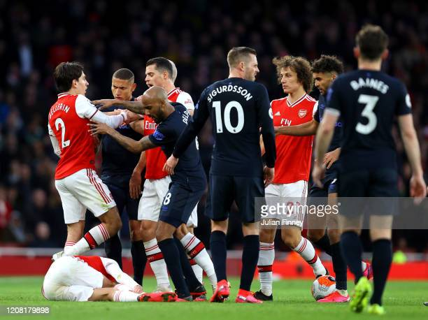 Players of Arsenal clash with Richarlison of Everton after a foul on Dani Ceballos of Arsenal that lead to a yellow card during the Premier League...
