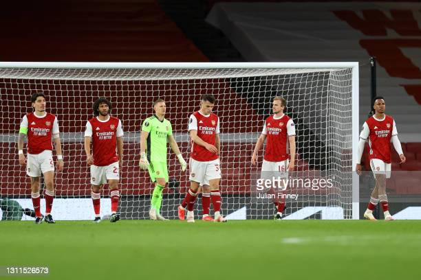 Players of Arsenal looks dejected after conceding their side's first goal scored by Tomas Holes of Slavia Praha during the UEFA Europa League Quarter...