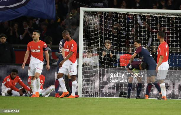 Players of AS Monaco react after the goal of Thiago Silva of Paris SaintGermain during the Ligue 1 match between Paris Saint Germain and AS Monaco at...