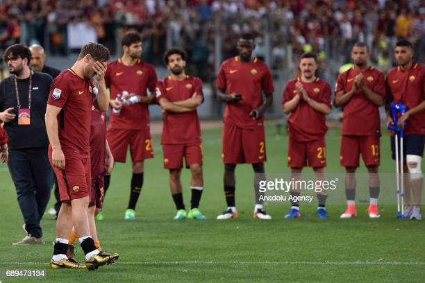 Players of AS Roma applause as Francesco Totti gestures after the Serie A Week 38 match between AS Roma and Genoa CFC at Stadio Olimpico in Rome...