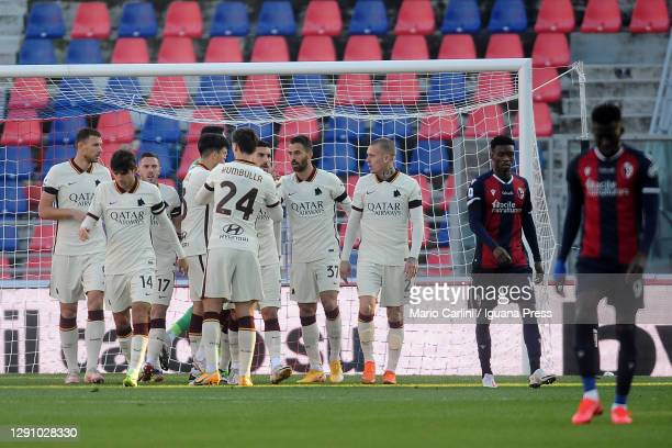 Players of AS Roma celebrate after the first goal during the Serie A match between Bologna FC and AS Roma at Stadio Renato Dall'Ara on December 13,...