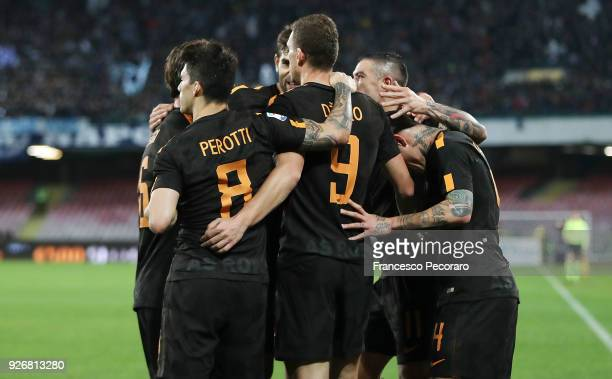 Players of AS Roma celebrate the 12 goal scored by Edin Dzeko during the serie A match between SSC Napoli and AS Roma Serie A at Stadio San Paolo on...