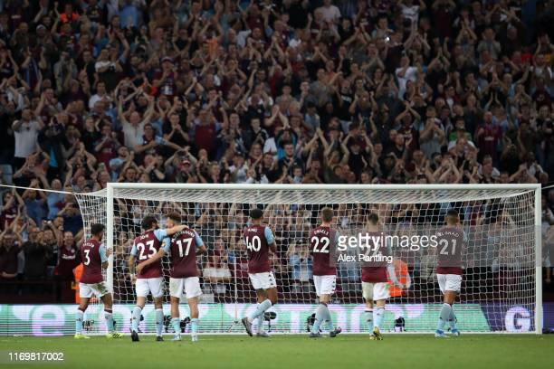 Players of Aston Villa celebrate with the fans following their sides victory in the Premier League match between Aston Villa and Everton FC at Villa...