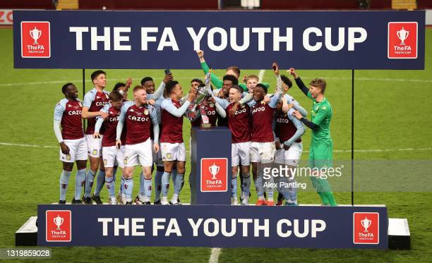 Players of Aston Villa celebrate with the trophy following the FA Youth Cup Final match between Aston Villa U18 and Liverpool U18 at Villa Park on...