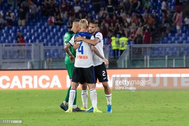 Players of Atalanta celebrates after scoring a goal during the Serie A match between AS Roma and Atalanta at Olimpico Stadium