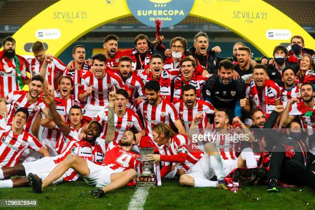 Players of Athletic Club celebrate victory with the trophy after the Supercopa de Espana Final match between FC Barcelona and Athletic Club at...