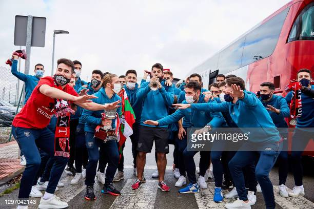 Players of Athletic Club celebrate with their fans with the Champions trophy during the arrival of the Athletic Club de Bilbao at Bilbao airport with...