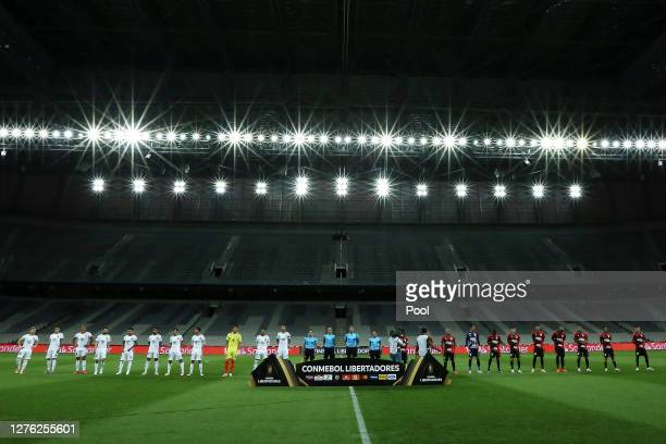 Players of Athletico Paranaense and of ColoColo observe a minute of silence in honor to victims of COVID19 before their group C match of Copa...