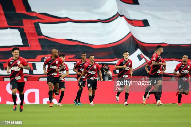 Players of Athletico Paranaense celebrate their first goal scored by Pedro Henrique during a group C match of Copa CONMEBOL Libertadores 2020 against...