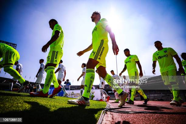 Players of Atlas and Pumas enter the pitch prior the 3rd round match between Pumas UNAM and Atlas as part of the Torneo Clausura 2019 Liga MX at...
