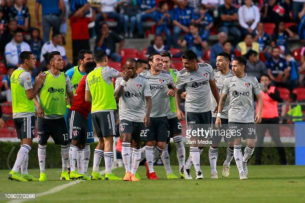 Players of Atlas celebrate the second goal of their team scored by Osvaldo Martínez during the first round match between Queretaro and Atlas as part...