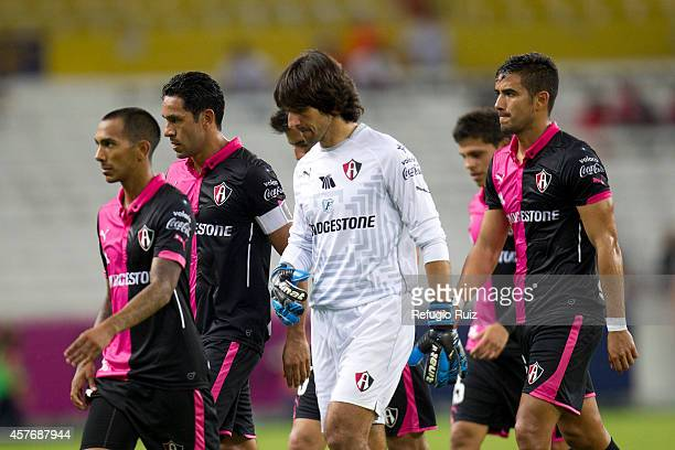 Players of Atlas look dejected after losing on penalties the game between Atlas and Puebla as part of Copa MX Apertura 2014 at Jalisco Stadium on...